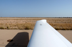 View past wing to the desert